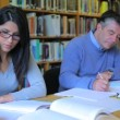 Stock Video: Studying in library
