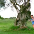 Girl running around tree — Stockvideo #25661011