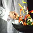 Stock Video: Chef tossing vegetable stir fry in wok