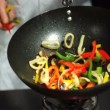 Stock Video: Chef tossing mixed vegetables in wok