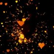 Golden confetti and sparks flying against heart — Vídeo de stock