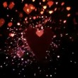 Sparks and confetti flying against heart — Stock Video #25665119