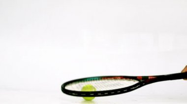 Tennis racket hitting a ball — Stock Video