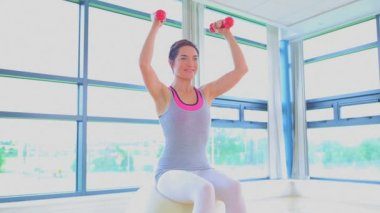 Woman doing exercise ball and dumbells — Stock Video