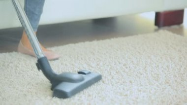 Woman vacuuming the carpet — Stock Video