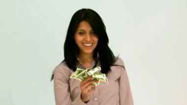 Happy woman fanning bills — Stock Video