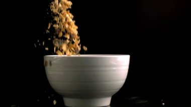 Bowl being filled by muesli — Stock Video