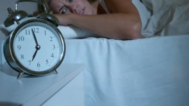 Blonde woman pushing down the alarm clock — Stock Video