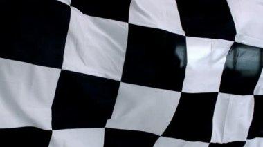 Geruit zwarte en witte vlag wapperend — Stockvideo