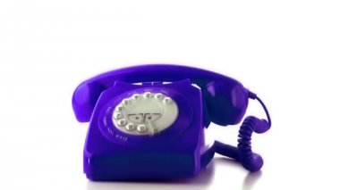 Receiver falling on purple dial phone — Stockvideo