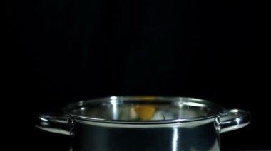 Habanero chili falling in pot — Stock Video