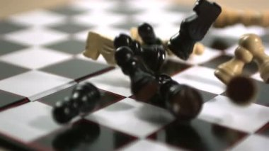 Chess pieces crashing onto board — Stock Video