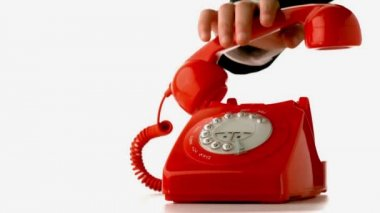Hand putting receiver down on red dial phone — Vidéo