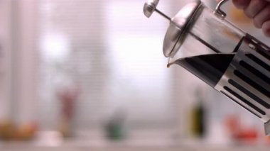 Cafetiere pouring coffee into cup — Stock Video