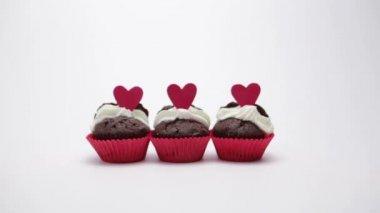 Three valentines cupcakes on white background — Stock Video