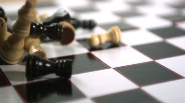 Chess pieces thrown across the board — Stock Video