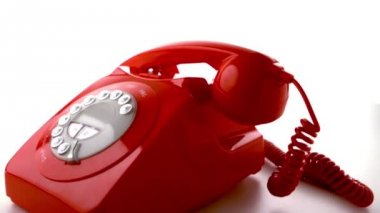 Red phone receiver dropping on dial phone — Vidéo