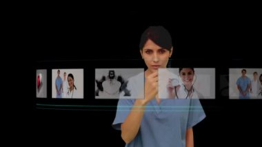 Nurse using digital interface to look at various x-rays — Stock Video
