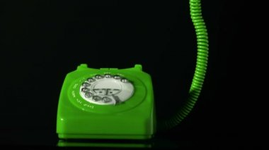 Receiver falling on green dial phone on black background — Vidéo