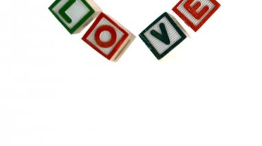 Building blocks spelling out love falling — Stock Video
