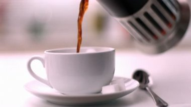 Coffee being poured into cup — Stock Video
