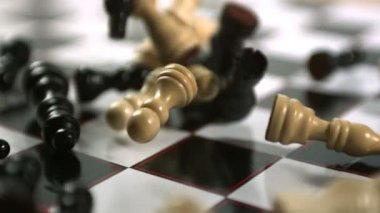 Chess pieces crashing on board — Stock Video