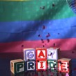 Heart confetti falling on blocks spelling gay pride — Stock Video
