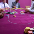 Man looking at his amazing poker hand and betting his house — Vídeo de stock
