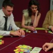 Four playing poker and one is folding — Stok Video #25676845