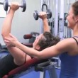 Trainer helping woman lifting weights — Stock Video