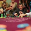 Stock video: Men placing bets and waiting for dealer