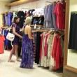 Woman looking in the mirror in a shop — Stock Video #25677569