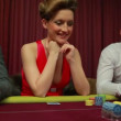 Woman looking at her poker hand — Vídeo de stock