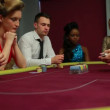 Dealer handing out cards at poker game — Stok Video #25678429
