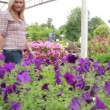 Mother and child standing at the garden centre — Stock Video