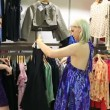 Stock Video: Women looking at dresses