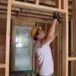 Stock Video: Builder hammering door frame