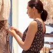 Stock Video: Woman dressing mannequin