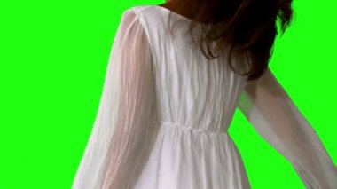 Girl in white dress twirling on green screen close up — Stock Video