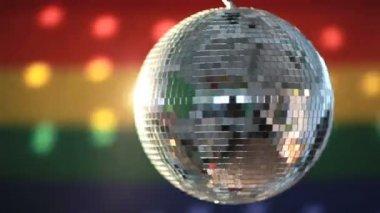 Disco ball revolving against gay pride flag — Stock Video