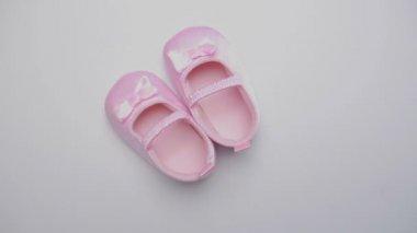 Pink baby booties — Stock Video