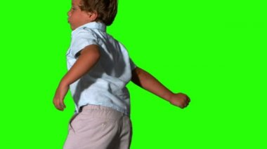 Little boy jumping and turning on green screen — Stock Video