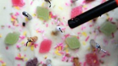 Hand lighting a revolving birthday cake — Stock Video
