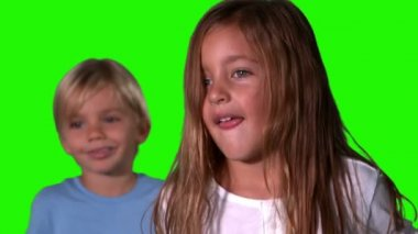 Cute siblings jumping together on green screen — Stock Video