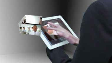 Businesswoman using tablet to view montage of business at work — Stock Video