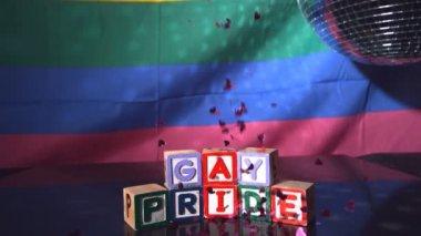 Heart confetti falling on blocks spelling gay pride — Stock Video