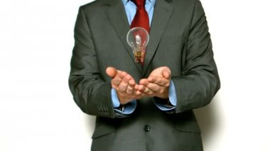 Man tossing light bulb — Stock Video
