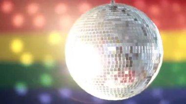 Disco ball spinning against rainbow flag — Stock Video
