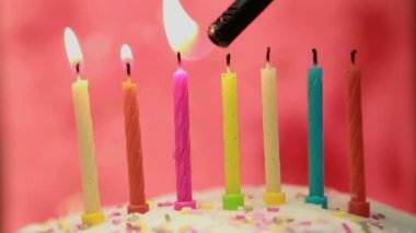 Birthday candles on cake being lit — Stock Video