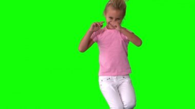 Joyful little girl jumping on green screen — Stock Video
